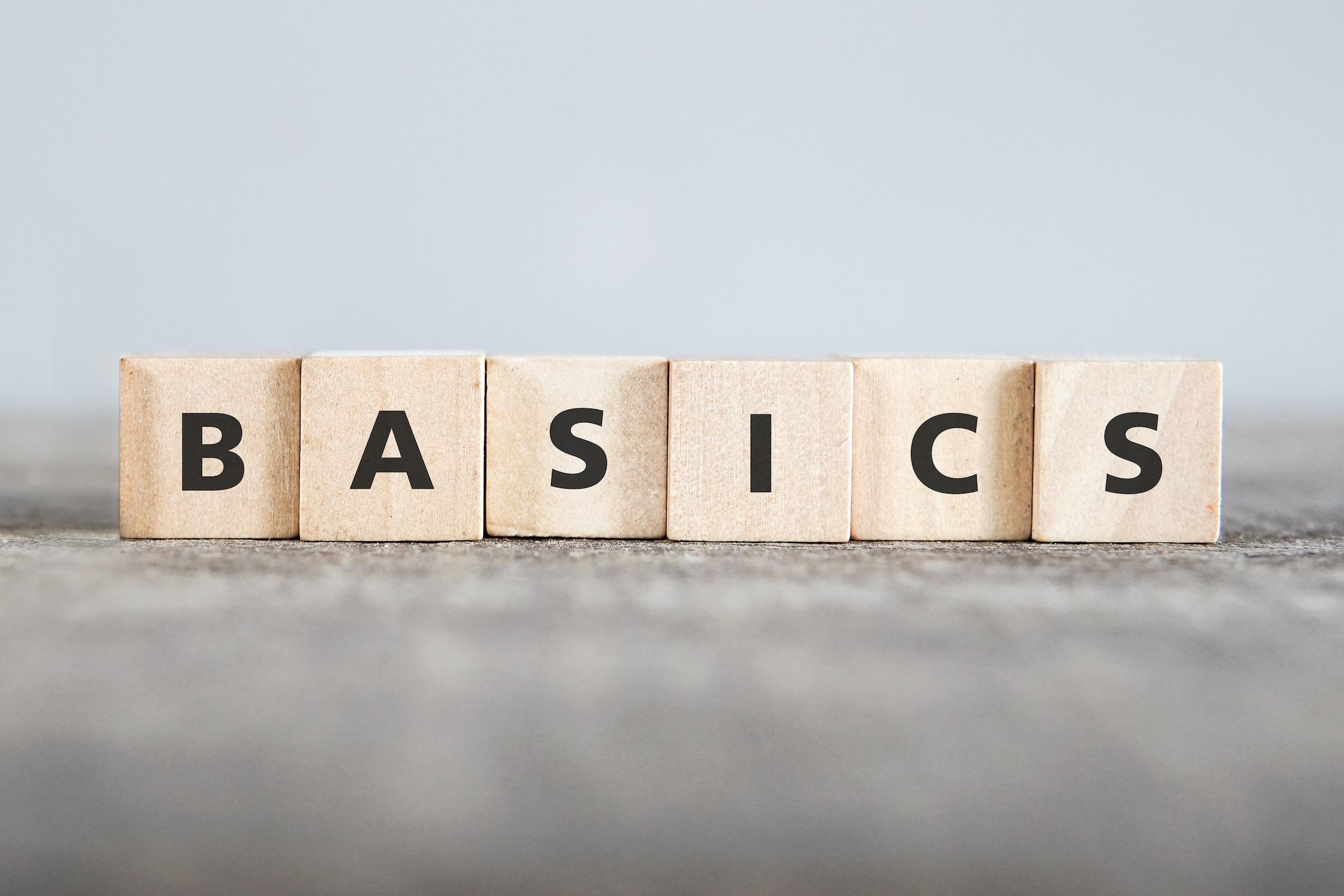 """""""Basic"""" spelled on wooden scrabble tiles"""