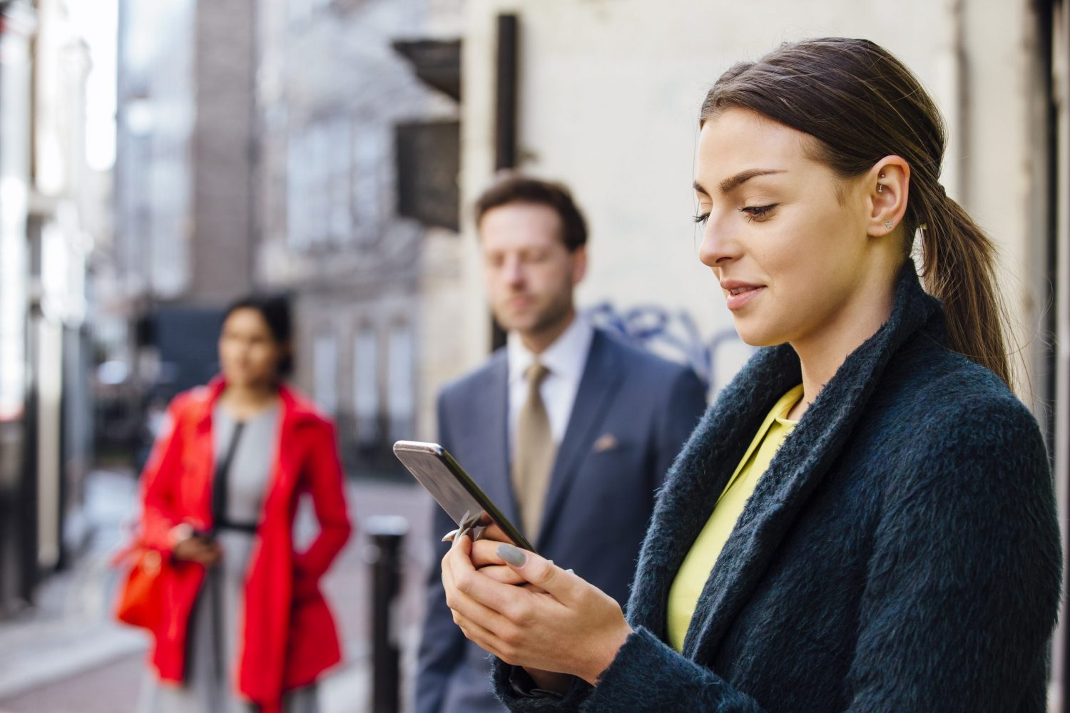 Business clients receiving instant CRM Alerts updates on smart phone and tablet
