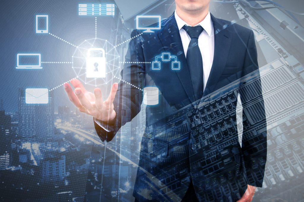 A businessman holding modern and futuristic secured apps and CRM platform